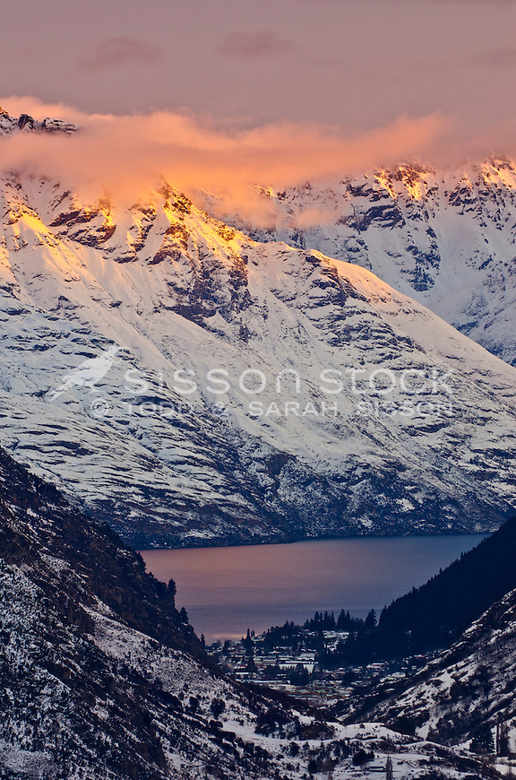 Sunset on Walter and Cecil Peaks and the Remarkables Mountains, Queenstown, seen from Coronet Peak road, South Island, New Zealand.