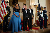United States President Barack Obama and first lady Michelle Obama pose for a photo with President Francois Hollande of France on Grand Staircase in the White House before the State Dinner in Hollande's honor in Washington, District of Columbia, U.S., on Tuesday, Feb. 11, 2014.  After an arrival ceremony on the South Lawn, Obama and Hollande met in the Oval Office for a policy meeting then gave a joint press conference in the East Room of the White House. <br /> Credit: Pete Marovich / Pool via CNP