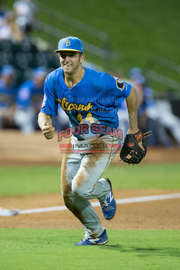 Myrtle Beach Pelicans third baseman Jason Vosler (44) charges towards home plate during the game against the Winston-Salem Dash at BB&T Ballpark on August 20, 2015 in Winston-Salem, North Carolina.  The Dash defeated the Pelicans 5-4 on a walk-off wild pitch in the bottom of the 9th inning.  (Brian Westerholt/Four Seam Images)