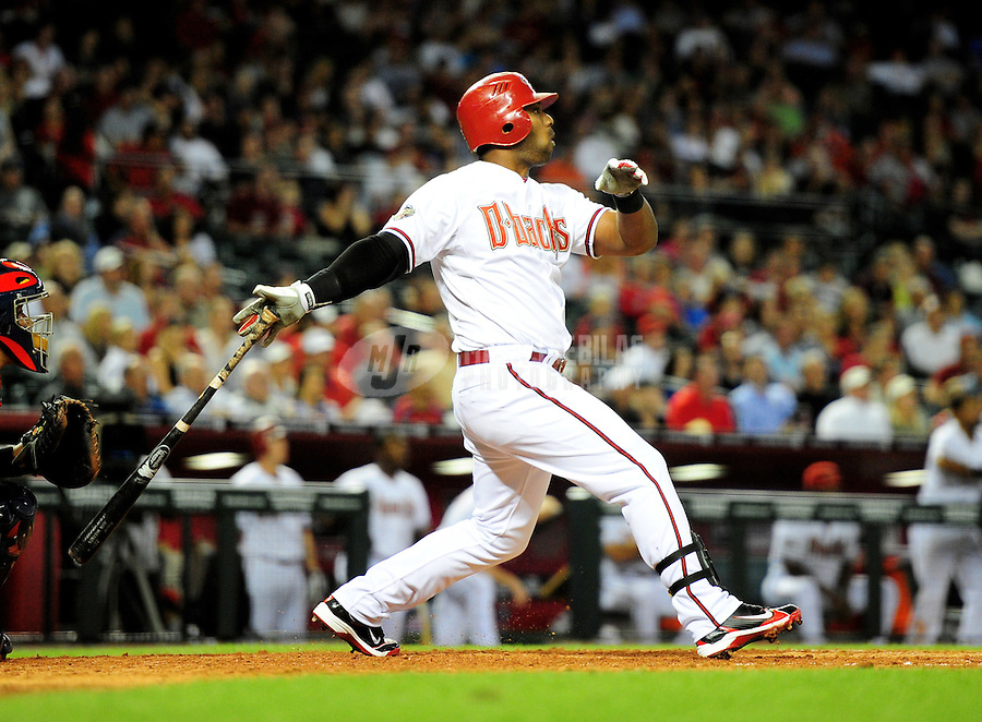 Apr. 12, 2011; Phoenix, AZ, USA; Arizona Diamondbacks batter Juan Miranda hits a three run home run in the sixth inning against the St. Louis Cardinals at Chase Field. Mandatory Credit: Mark J. Rebilas-