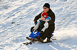 MIDDLEBURY, CT-122617JS01----Dan Legg of Middlebury and his son Evan Legg, 7, make their way down the hill while sledding Tuesday at the Shepardson Community Center in Middlebury. <br /> Jim Shannon Republican-American