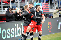 WASHINGTON, DC - FEBRUARY 29: Washington, D.C. - February 29, 2020: Russell Canouse #4 of D.C. United celebrating his score with teammates Steven Birnbaum #15 and Felipe Martins #18. The Colorado Rapids defeated D.C. Untied 2-1 during their Major League Soccer (MLS)  match at Audi Field during a game between Colorado Rapids and D.C. United at Audi Field on February 29, 2020 in Washington, DC.