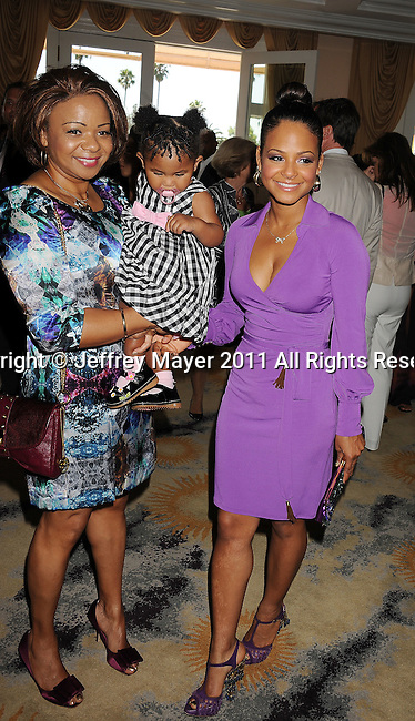 BEVERLY HILLS, CA - APRIL 17: Christina Milian, mother and daughter arrive at the Silver Rose Gala And Auction at Beverly Hills Hotel on April 17, 2011 in Beverly Hills, California.
