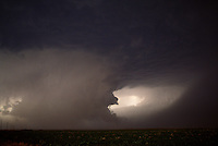 A dramatic view of a rotating wall cloud from a severe thunderstorm in the Texas panhandle in June. Such cloud formations can precede the development of destructive tornadoes.