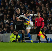 Brighton &amp; Hove Albion's Solly March (right) is tackled by Burnley's Ben Mee (left)<br /> <br /> Photographer David Horton/CameraSport<br /> <br /> The Premier League - Brighton and Hove Albion v Burnley - Saturday 9th February 2019 - The Amex Stadium - Brighton<br /> <br /> World Copyright &copy; 2019 CameraSport. All rights reserved. 43 Linden Ave. Countesthorpe. Leicester. England. LE8 5PG - Tel: +44 (0) 116 277 4147 - admin@camerasport.com - www.camerasport.com