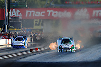 Sept. 3, 2010; Clermont, IN, USA; NHRA funny car driver Ashley Force Hood (right) during qualifying for the U.S. Nationals at O'Reilly Raceway Park at Indianapolis. Mandatory Credit: Mark J. Rebilas-