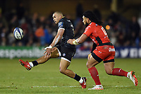 Jonathan Joseph of Bath Rugby puts boot to ball. European Rugby Champions Cup match, between Bath Rugby and RC Toulon on December 16, 2017 at the Recreation Ground in Bath, England. Photo by: Patrick Khachfe / Onside Images