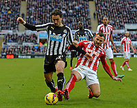 Phillip Bardsley of Stoke City tackles Daryl Janmaat of Newcastle United