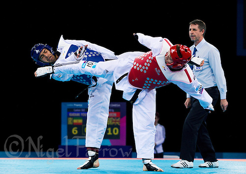 04 DEC 2011 - LONDON, GBR - Yousef Karami (IRI) (on left, in blue) battles with Aaron Cook (GBR) (on right, in red) during their men's -80kg category quarter final round contest at the London International Taekwondo Invitational and 2012 Olympic Games test event at the ExCel Exhibition Centre in London, Great Britain .(PHOTO (C) NIGEL FARROW)