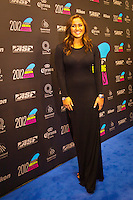 GOLD COAST, Queensland/Australia (Friday, February 24, 2012) Carissa Moore (HAW).  The 29th Annual ASP World Surfing Awards went off tonight at the Gold Coast Convention and Exhibition Centre with the worlds best surfers trading the beachwear for formal attire as the 2011 ASP World Champions were officially crowned.. .Kelly Slater (USA), 40, and Carissa Moore (HAW), 19, took top honours for the evening, collecting the ASP World Title and ASP Womens World Title respectively.. .I have actually been on tour longer than some of my fellow competitors have been alive, Slater said. All joking aside, its truly humbling to be up here and honoured in front of such an incredible collection of surfers. I want to thank everyone in the room for pushing me to where I am...In addition to honouring the 2011 ASP World Champions, the ASP World Surfing Awards included new accolades voted on by the fans and the surfers themselves...For the first time in several years, ASP Life Membership was awarded to Hawaiian legend and icon of high-performance surfing, Larry Bertlemann (HAW), 56...Where surfing is today is where I dreamed it should be in the 70s, Bertlemann said. You guys absolutely deserve this and Im so honored to be up here in front of you all tonight..Grammy Award-winning artists Wolfmother and The Vernons rounded out the nights entertainment which was all streamed LIVE around the world on YouTube.com..Photo: joliphotos.com
