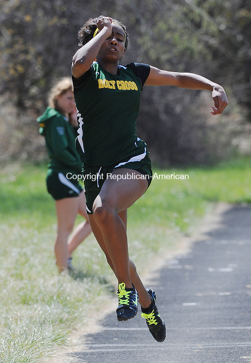 """WATERBURY, CT-10 APRIL 2012--041012JS11-Holy Cross' Briana Bradford took first place in the long jump with a jump of 14' 7"""" during their meet with Sacred Heart and Wilby Tuesday at Holy Cross High School in Waterbury. .Jim Shannon Republican-American"""