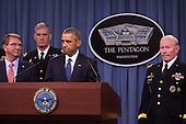 United States President Barack Obama delivers remarks after meeting with members of his national security team concerning ISIS at the Pentagon in Washington, D.C. on Monday, July 6, 2015. From left, Secretary of Defense Ashton Carter, Commander of U.S. Africa Command Gen. David Rodriguez, and Chairman of the Joint Chiefs of Staff U.S. Army General Martin Dempsey.<br /> Credit: Drew Angerer / Pool via CNP