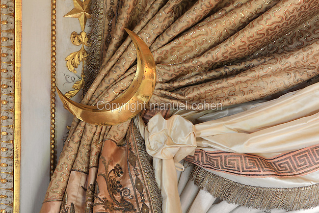 "Detail of curtain tie backs crescent moon shapped, Turkish Boudoir, redesigned in 1777 for Marie Antoinette, by architect Richard Mique, Chateau de Fontainebleau, France. The decoration is the achievement of the brothers Rousseau, and the furniture dates to the period of the First Empire, with precious textile work done by Jacob-Desmalter for Empress Josephine. Including a small bedroom, mirrors, and curtains raised by pulleys, this exceptional ensemble has been restored in 2014 thanks to the support of INSEAD and the generosity of subscribers of sponsors belonging to the group ""Des Mécènes pour Fontainebleau"". Its opening to the public is schedule for Spring 2015. Picture by Manuel Cohen"