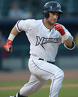 NWA Democrat-Gazette/ANDY SHUPE<br /> Northwest Arkansas Naturals catcher Nick Dini heads to first Wednesday, July 11, 2018, after an infield hit to score third baseman Kelvin Gutierrez against the Tulsa Drillers during the fourth inning at Arvest Ballpark in Springdale. Visit nwadg.com/photos to see more photographs from the game.