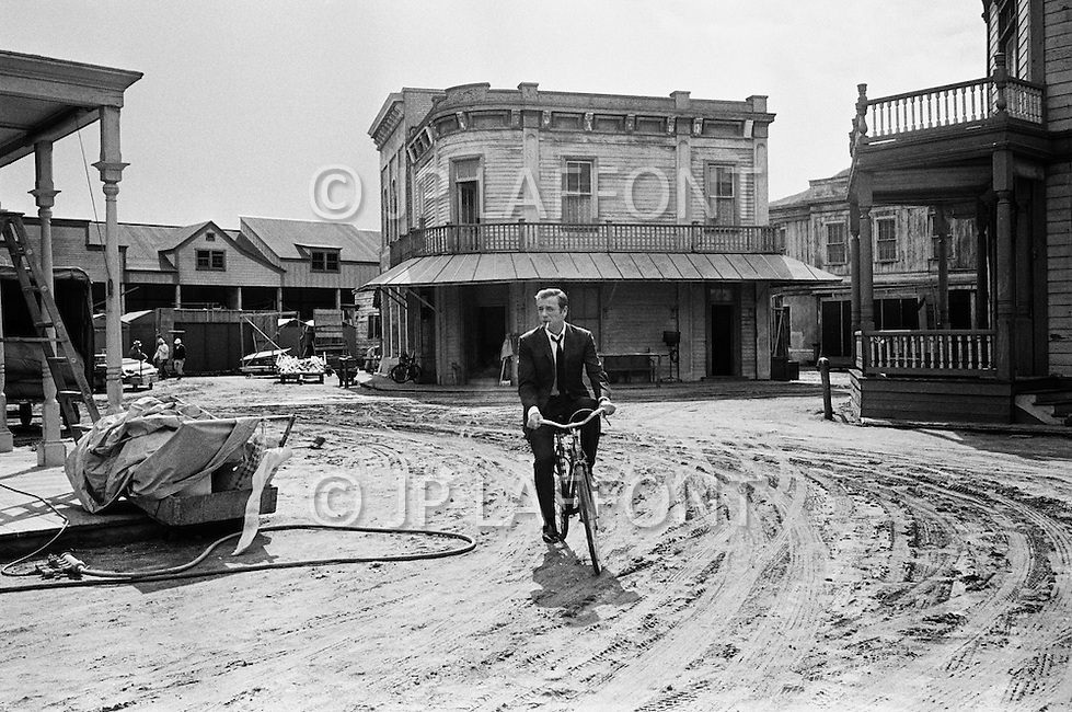 "Hollywood, Los Angeles, California, USA. March 10th, 1969. French actor and singer Yves Montand walking out of a jail on the set of a western movie at Paramount Studios. Montand was an immensely popular as singer and movie actor and most famous for his dramatic role in the 1953 thriller ""The Wages of Fear"". He was acting on Vincent Minelli film: On a Clear Day You Can See Forever with Barbra Streisand."
