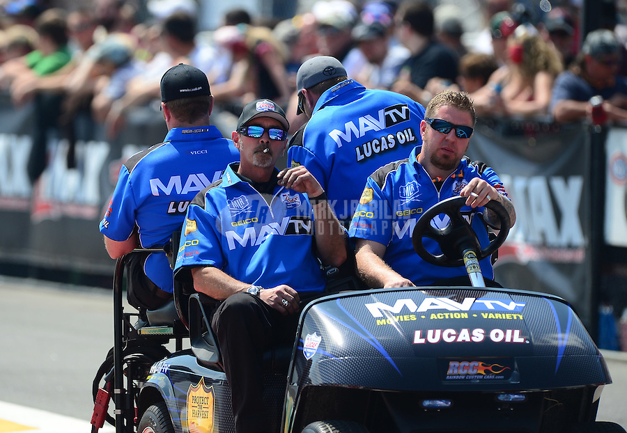 Apr. 15, 2012; Concord, NC, USA: NHRA crew members for top fuel dragster driver Brandon Bernstein during eliminations for the Four Wide Nationals at zMax Dragway. Mandatory Credit: Mark J. Rebilas-