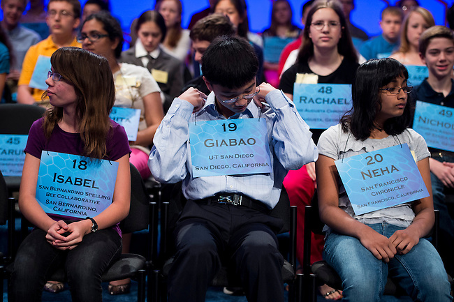 Speller No. 018, Isabel Cholbi, 019, Giabao Tonthat, 13 and 020, Neha Konakalla compete in the preliminary rounds of the Scripps National Spelling Bee at the Gaylord National Resort and Convention Center in National Habor, Md., on Wednesday, May 29, 2013. Photo by Bill Clark