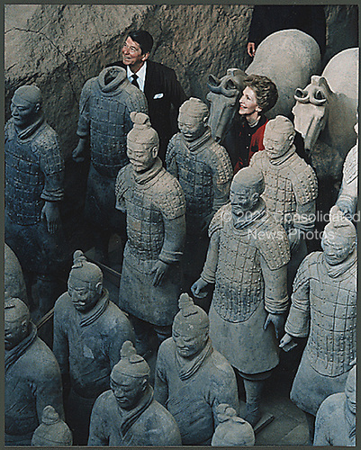 U.S. President Ronald Reagan and First Lady Nancy Reagan stand with the Terra Cotta figures in Xi'an, China on April 29, 1984.<br /> Credit: White House via CNP