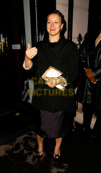 "SAMANTHA MORTON.At The ""Forever Marilyn"" Private View & Charity Auction, Scream Gallery, London, England, October 23rd 2006..full length black coat shoes hand gesture funny.Ref: CAN.www.capitalpictures.com.sales@capitalpictures.com.©Can Nguyen/Capital Pictures"