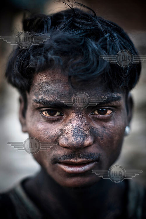 Tinku Bhuia works for about 10 hours a day, earning 150 Indian Rupees (3.5USD), loading coal trucks in the BCCL (Bharat Coking Coal Limited) coal mines.