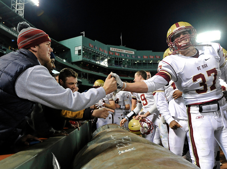 (Boston, MA, 11/25/15) Fans congratulate Boston College High School players after they beat Catholic Memorial in the fourth quarter of a high school football game at Fenway Park in Boston on Wednesday, November 25, 2015. Staff photo by Christopher Evans