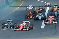 March 20, 2016: Sebastian Vettel (DEU) #5 from the Scuderia Ferrari team takes the lead after the start of the 2016 Australian Formula One Grand Prix at Albert Park, Melbourne, Australia. Photo Sydney Low