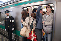 Commuters squeeze onto a train. Tokyo has one of the most extensive and efficient transport networks in the world - but also one of the most crowded. Rail companies calculate crowding by percent of standard capacity (ie when all the seats and standing spaces are occupied). Some trains reach 220%+.