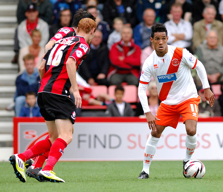 Blackpool's Thomas Ince vies for possession with Bournemouth's Shaun MacDonald<br /> <br /> Photo by Ashley Crowden/CameraSport<br /> <br /> Football - The Football League Sky Bet Championship - Bournemouth v Blackpool - Saturday 14th September 2013 - Goldsands Stadium - Bournemouth<br /> <br /> &copy; CameraSport - 43 Linden Ave. Countesthorpe. Leicester. England. LE8 5PG - Tel: +44 (0) 116 277 4147 - admin@camerasport.com - www.camerasport.com