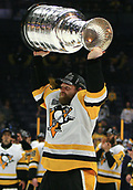 June 11th 2017, Nashville, TN, USA;  Pittsburgh Penguins right wing Phil Kessel (81) skates with the Stanley Cup following Game 6 of the Stanley Cup Final between the Nashville Predators and the Pittsburgh Penguins, held on June 11, 2017, at Bridgestone Arena in Nashville, Tennessee.