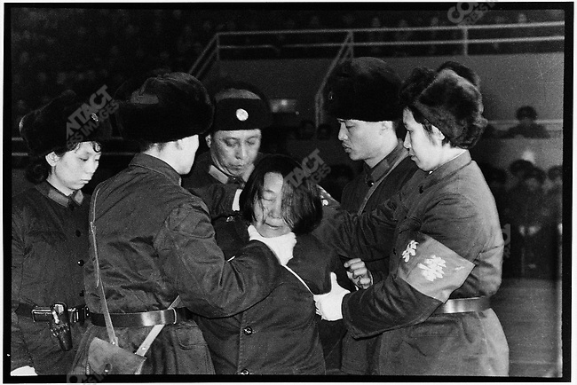 After being sentanced to death for embezzlement bailiffs dislocate Wang Shouxin's jaw to stop her from proclaiming her innocence. She is then transported by truck to a snowy field on the rural outskirts of Harbin to be executed. Harbin, 8 February 1980