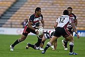 Samisoni Fisilau takes the ball forward as Anthony Tuitavake moves in for the tackle. Air New Zealand Cup rugby game between Counties Manukau Steelers & North Harbour, played at Mt Smart Stadium on Saturday 4th of  October 2008. After being tied up 14 all at halftime North Harbour went on to win 57 - 28.