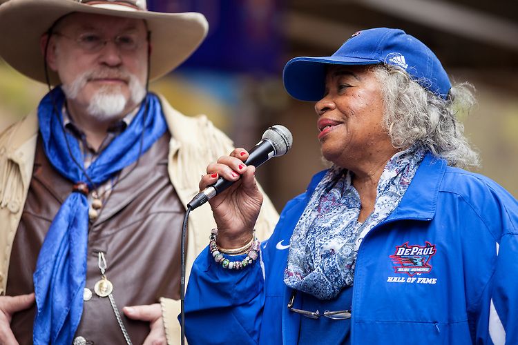 """Mabel """"Dolly"""" Landry Staton, DePaul alumna, olympian and track star, right, with Bro. Mark Elder, C.M., addresses a group in attendance for the """"Little School Under the 'L, 'under the L'"""" public art project, Saturday, Oct. 15, 2016. The murals, which wrap around pillar's underneath the CTA's Fullerton 'L' stop, depict important historical figures from DePaul's past. Figures in include legendary DePaul basketball coach Ray Meyer, civil rights activist and judge Benjamin Hooks, Staton, and the first women graduates of DePaul. The five murals installed are part of a larger project to add at total of 24 over the next several years, with more prominent DePaul figures. (DePaul University/Joel Dik)"""