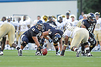 17 September 2011:  FIU offensive lineman Giancarlo Revilla (53) prepares to snap the ball in the first quarter as the FIU Golden Panthers defeated the University of Central Florida Golden Knights, 17-10, at FIU Stadium in Miami, Florida.