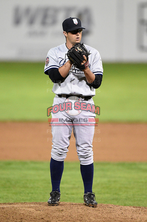 Staten Island Yankees pitcher Joe Harvey (52) gets ready to deliver a pitch during a game against the Batavia Muckdogs on August 7, 2014 at Dwyer Stadium in Batavia, New York.  Staten Island defeated Batavia 2-1.  (Mike Janes/Four Seam Images)