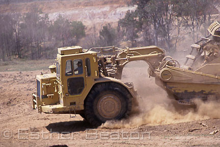 Earthmoving equipment creating dust at waste landfill site, near Badgery's Creek, western S ydney, New South Wales