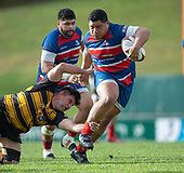 Sesimani Tupou tries to break free from Mitchell Thackham. Counties Manukau Premier 1 McNamara Cup Final between Ardmore Marist and Bombay, played at Navigation Homes Stadium on Saturday July 20th 2019.<br />  Bombay won the McNamara Cup for the 5th time in 6 years, 33 - 18 after leading 14 - 10 at halftime.<br /> Photo by Richard Spranger.