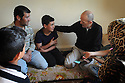SARAB AL-AHMAD, 28 AND HASAN SHARIF, 41, AND THEIR CHILDREN FROM DAMASCUS, SYRIA SIT WITH PASTOR AMJAD   IN THEIR NEW HOME IN MADABA, JORDAN. 20/04016. PHOTO CLARE KENDALL.