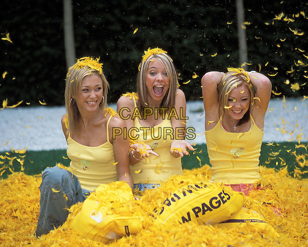 ATOMIC KITTEN..Ref: 10949..yellow, feathers, promoting, promotion, laughing, fun, vest,  ..half length, half-length..www.capitalpictures.com..sales@capitalpictures.com..©Capital Pictures..