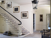The entrance hall has a staircase which is a copy of an early Georgian style
