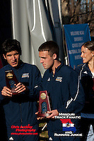 Northern Arizona's Caleb Hoover stands on the awards podium after receving a trophy for the team's 4th place finish at the 2012 NCAA Division I Cross Country Championships. Hoover, the multiple Missouri State High School Champion for College Heights Christian, helped the Lumberjacks to a surprise trophy finish with his 75th place finish in the 245 man field clocking a 30:31 for the 10k race Saturday, November 17, at E.P. Tom Sawyer State Park in Louisville, KY.