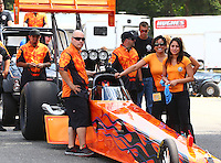 Aug. 2, 2014; Kent, WA, USA; Crew members for NHRA top fuel dragster driver Mike Salinas waiting in the staging lanes during qualifying for the Northwest Nationals at Pacific Raceways. Mandatory Credit: Mark J. Rebilas-
