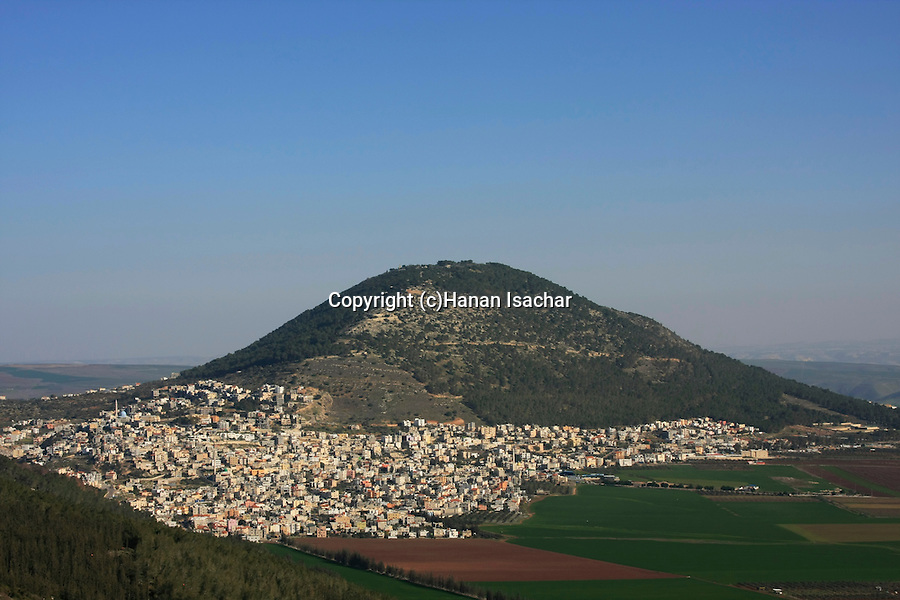 Israel, Lower Galilee. A view of Mount Tabor and Arab village Daburiya at its foothill from Bet Keshet scenic road