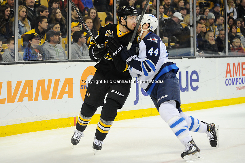 January 2, 2014 - Boston, Massachusetts, U.S. - Boston Bruins left wing Daniel Paille (20) and Winnipeg Jets defenseman Zach Bogosian (44) collide  during the NHL game between Winnipeg Jets and the Boston Bruins held at TD Garden in Boston Massachusetts.  Boston defeated Winnipeg 4-1 in regulation. Eric Canha/CSM