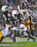 26 September 2009:  Iowa DEs Broderick Binns (91) and Adrian Clayborn (94) cause Penn State QB Daryll Clark (17) to fumble in the end, resulting in a safety.  The Iowa Hawkeyes defeated the Penn State Nittany Lions 21-10 at Beaver Stadium in State College, PA.
