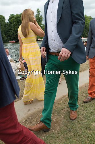 Henley on Thames UK. Man wearing red green orange coloured trousers.