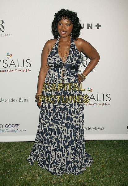 JENNIFER HUDSON.Sixth Annual Chrysalis Butterfly Ball held at the Home of Susan Harris and Hayward Kaiser, Mandeville Canyon, California, USA, 02 June 2007..full length black and white patterned print halterneck dress hand on hip.CAP/ADM/RE.©Russ Elliot/AdMedia/Capital Pictures. *** Local Caption *** ..