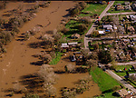 January 3, 1997--1997 Flood--Parkdale Dr. and the Tuolumne River.  A series of subtropical storms, collectively called a pineapple express, struck northern California from late December 1996 to early January 1997.  December 1996 was one of the wettest Decembers on record.  For the first time since its completion in 1971, water began spilling over the dam at Don Pedro Reservoir in western Tuolumne County on Thursday. This caused a dramatic rise of the Tuolumne River and Dry Creek in Stanislaus County. Early Friday morning, the level of the Tuolumne River in Modesto reached 55 feet, which is flood stage. Unfortunately, the river continued to rise rapidly all afternoon, reaching an astonishing 70 feet by late Friday evening.   One neighborhood along Dry Creek just east of downtown Modesto was under as much as 15 feet of water, as were neighborhoods along the Tuolumne River in southwest Modesto.<br /> Photo by Al Golub/Modesto Bee