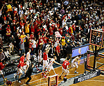 SIOUX FALLS, SD - MARCH 22: The Ferris State bench storms the court at the conclusion of their semifinal game against West Texas A&M at the 2018 Elite Eight Men's NCAA DII Basketball Championship at the Sanford Pentagon in Sioux Falls, SD. Ferris State won 85-79 to advance to the finals on Saturday. (Photo by Dave Eggen/Inertia)
