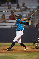 Mooresville Spinners pinch-hitter Jacob Whitley (35) (Charlotte) follows through on his swing against the Lake Norman Copperheads at Moor Park on July 6, 2020 in Mooresville, NC.  The Spinners defeated the Copperheads 3-2. (Brian Westerholt/Four Seam Images)