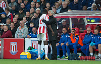 Man Utd Manager Jose Mourinho hugs loanee Kurt Zouma of Stoke City as he takes a throw in during the Premier League match between Stoke City and Manchester United at the Britannia Stadium, Stoke-on-Trent, England on 9 September 2017. Photo by Andy Rowland.